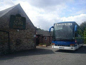 Picture of a coach in The Stag card park